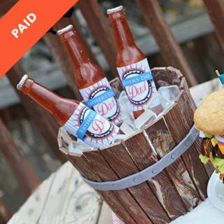 edible beer bottle cake with realistic wooden barrel and sugar ice cubes
