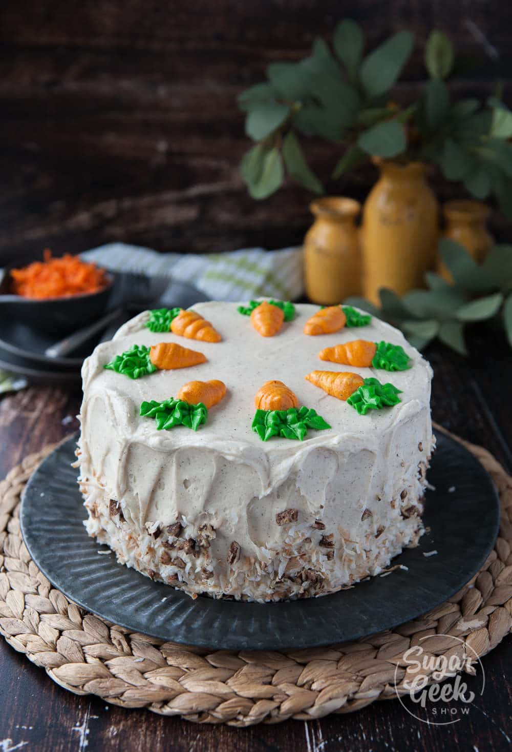 Homestyle carrot cake with pineapple, toasted coconut, candied pecans and big chunks of carrots. Frosted with brown butter cream cheese frosting and buttercream carrots