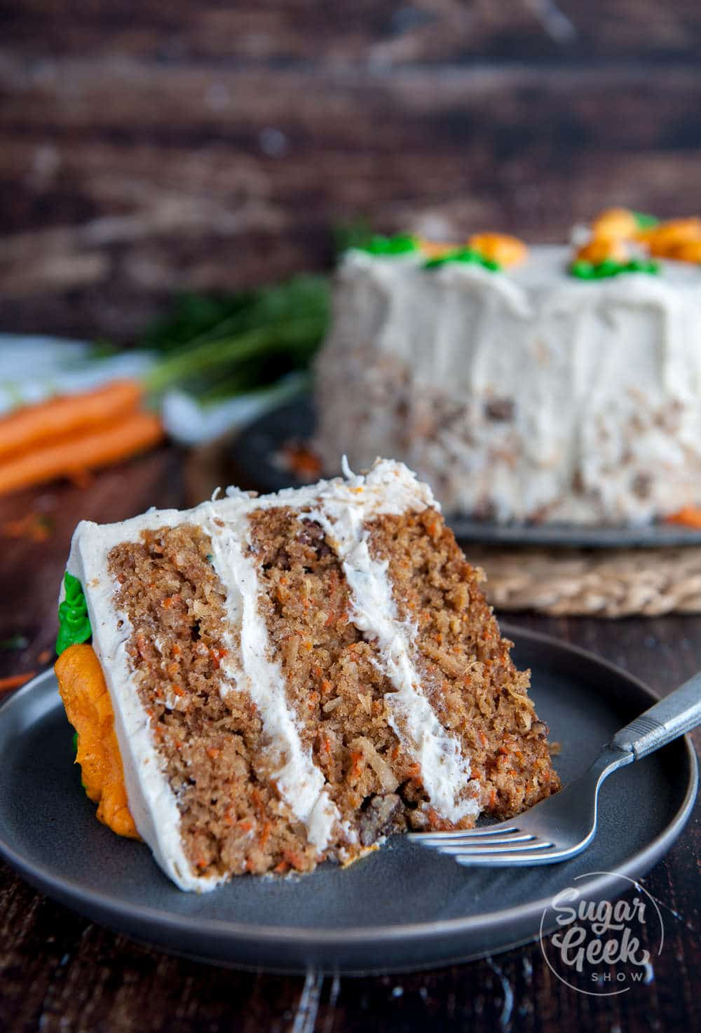 carrot cake with pineapple, candied pecans, toasted coconut and big chunks of carrots. Frosted with brown butter cream cheese frosting