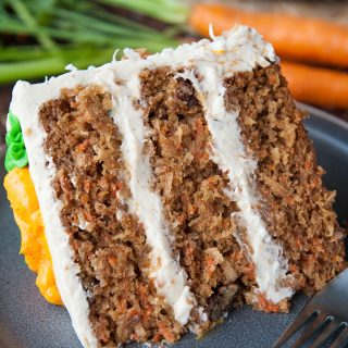 Moist carrot cake with pineapple, toasted coconut, candied pecans and big chunks of carrots. Frosted with brown butter cream cheese frosting