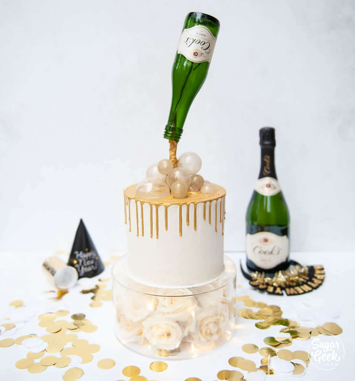 champagne cake with gravity defying bottle