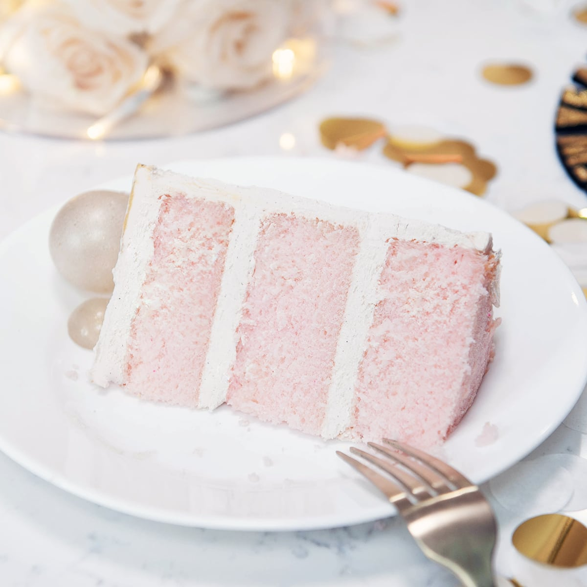 closeup of champagne cake on a white plate