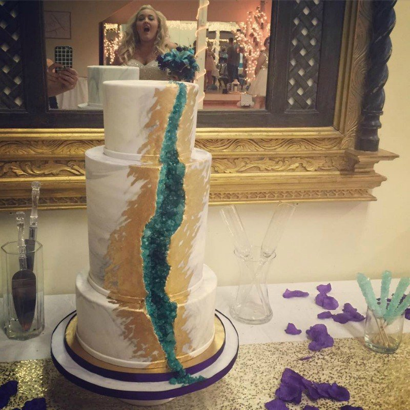 Bride reacts to geode wedding cake
