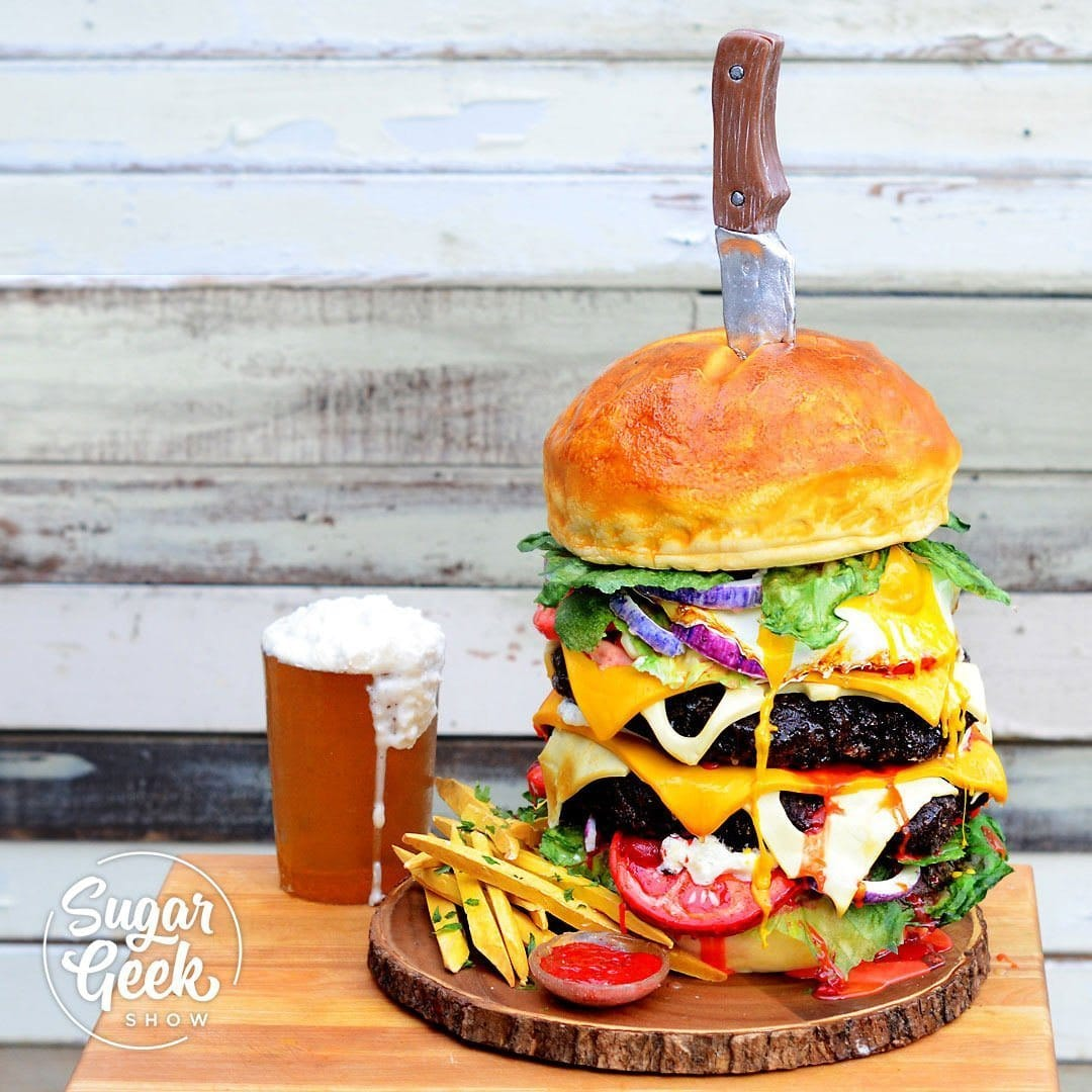 Featuring many of the tricks and techniques used on Food Network's new Ridiculous Cakes TV show, this burger and beer cake is a great manly cake!Featuring a edible candy versions of lettuce, tomatoes, onions, cheese, hamburger patties and our beer glass gummy that tastes like an actual beer, this cake is sure to be a crowd-stopper.