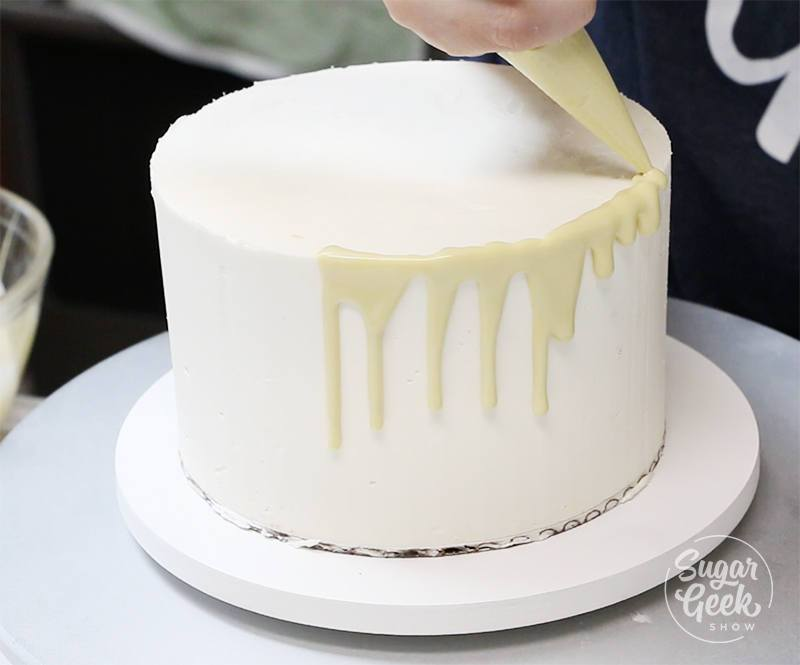 how to pour white chocolate ganache drip onto a cake