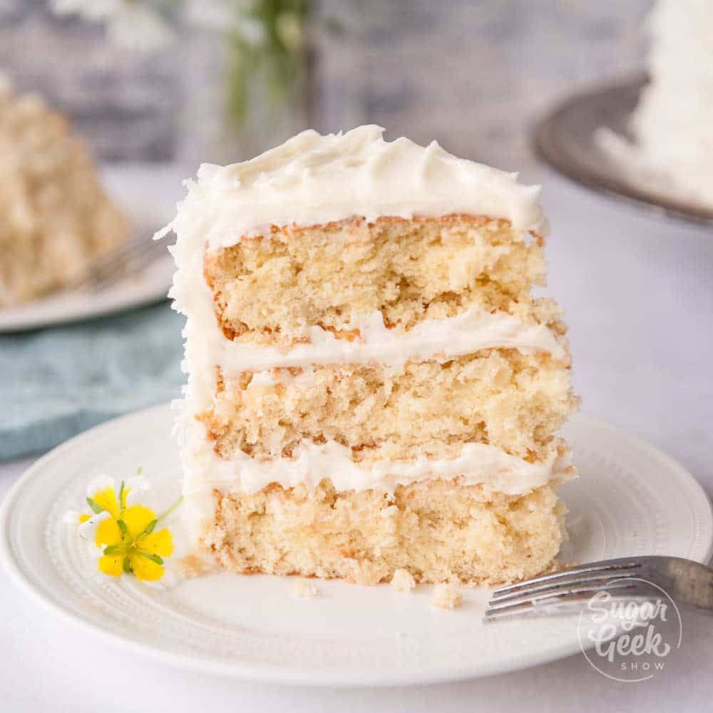 southern coconut cake made with toasted coconut and coconut cream cheese frosting
