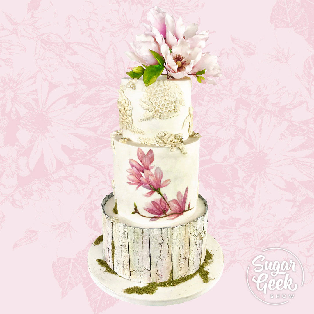 This month's guest instructor is the one-and-only Sara Weber of Sara's Sweets in Austin, Texas. Sara brings us a dosey of a cake design, complete with saucer magnolias, rustic wooden fence planks, a bee-utiful bee bas relief design and a botanical watercolor flower illustration tying several techniques into one seamless cake.