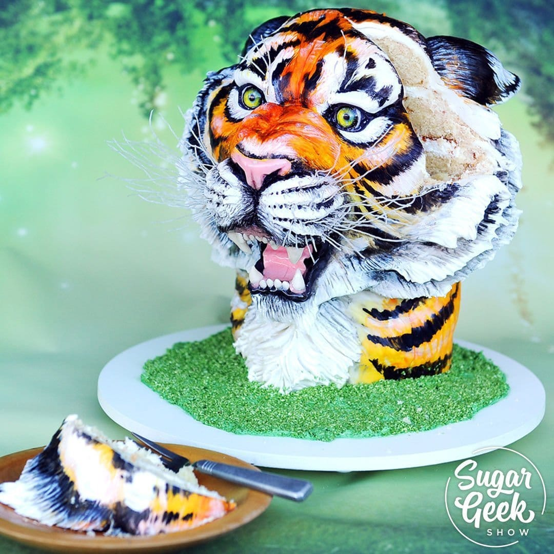 Learn to make a sculpted tiger cake that's all cake! Yep, even the mouth. Liz shows you how to stack, carve, get the right proportions, and make realistic details like teeth, sugar eyes and cocoa butter painting.