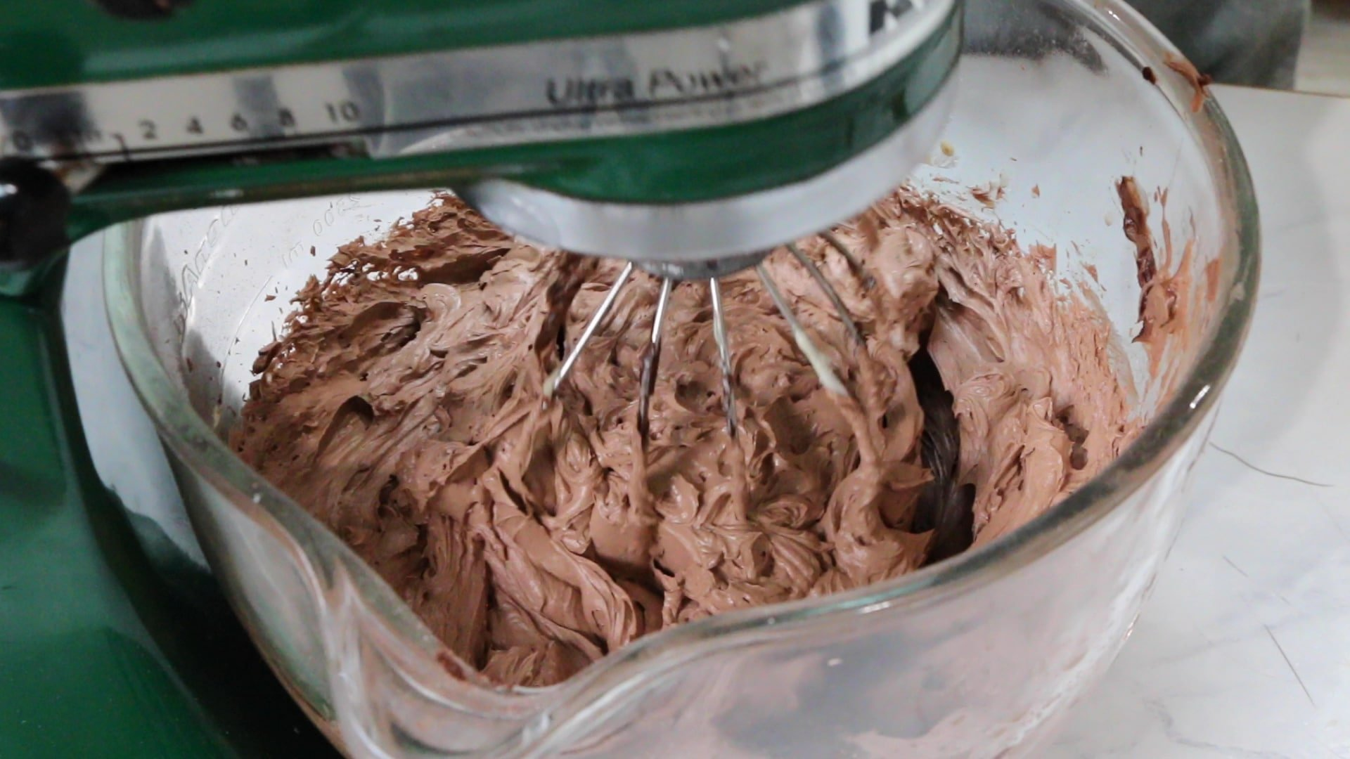 whipping chocolate buttercream in a stand mixer