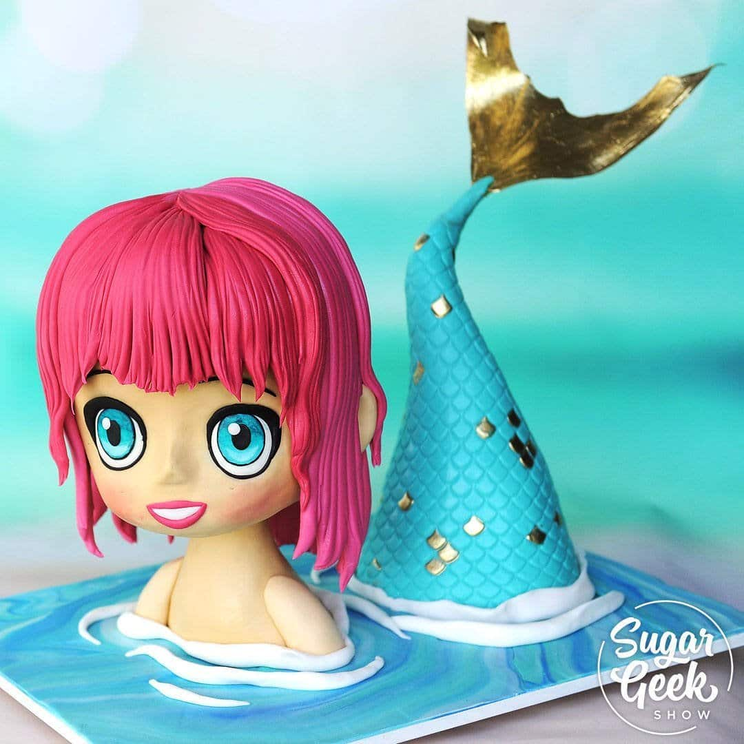 Liz's latest tutorial is here and it's full of cute! Liz made this adorable sculpted mermaid cake for her best friends daughter's 5th birthday! In this tutorial you'll learn how to a make a gravity-defying structure, how to sculpt those adorable proportions, make flexible gelatin mermaid tail, hand-painted details and more!