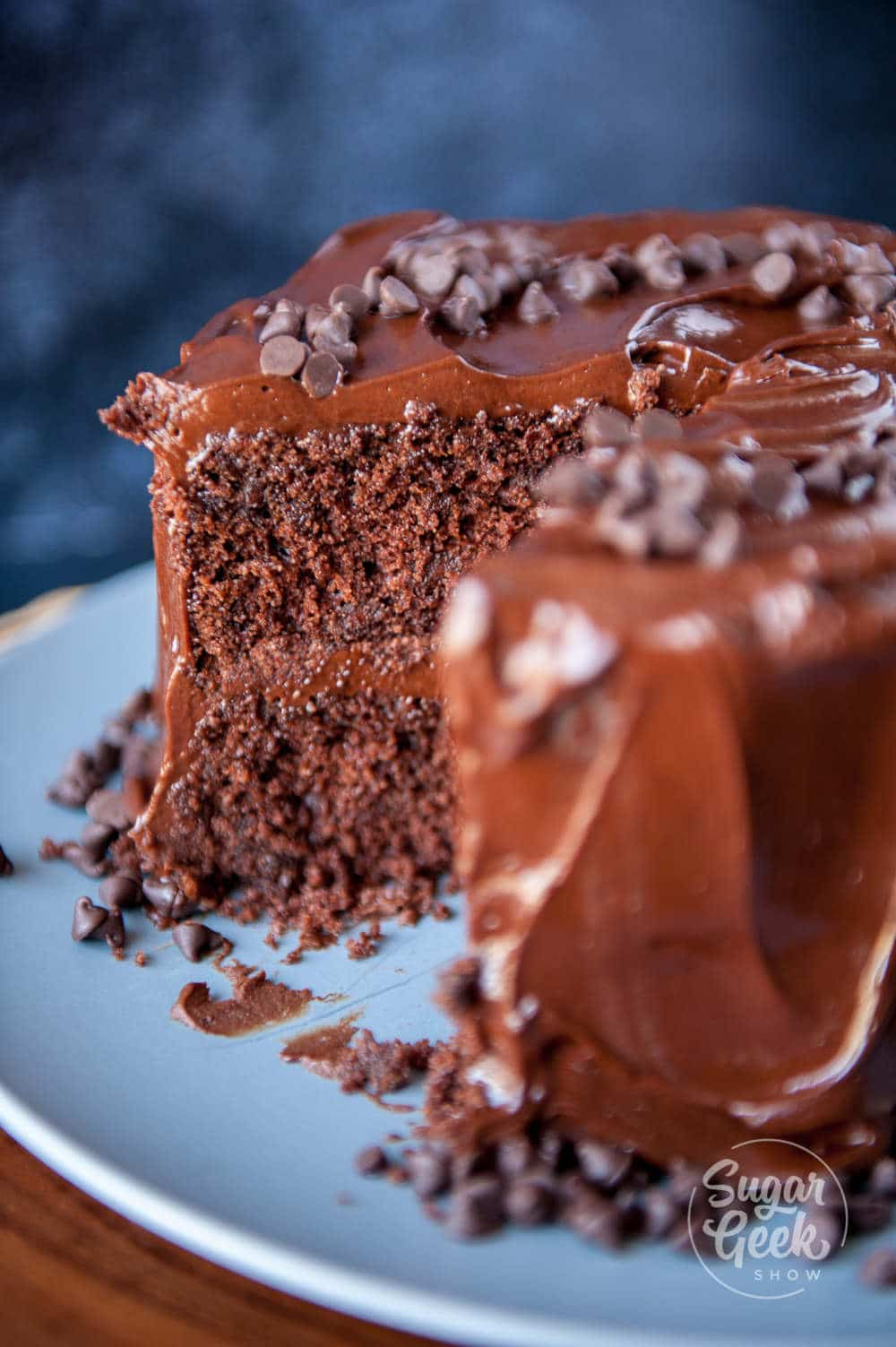 close up of chocolate cake with slice cut out of it