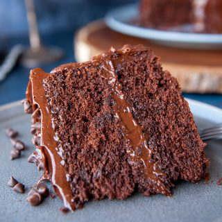 closeup of slice of chocolate wasc cake with chocolate ganache