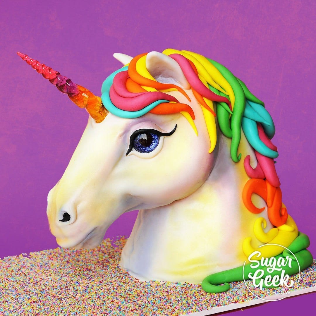Unicorn cakes are super trendy right now, and what better way to embrace this trend than to innovate on it. Liz Marek returns for her take on the unicorn trend, with a realistic, 80s-tastic neon unicorn bust cake.   This cake features real horse anatomy, a glowing isomalt (or Jolly Rancher) unicorn horn, beautiful sparkly eyes and a neon-rainbow unicorn mane.  Wow your clients and up your cake game with this stunning cake design, sure to be a show-stopper at your next event.