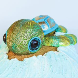 sculpted turtle cake with gold crackled fondant texture and cute edible glitter eyes