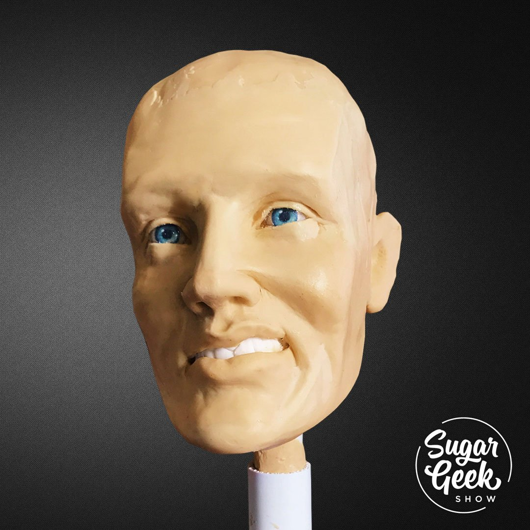 Learning to sculpt a face can seem so daunting but with Liz's formula for sculpting realistic faces, you'll be on your way in no time. Learn how to sculpt a male face using Liz's chocolate skull mold, realistic sugar eyes and artist calipers. Learn how to keep proportions check your work and even tips for getting sculpting a portrait.