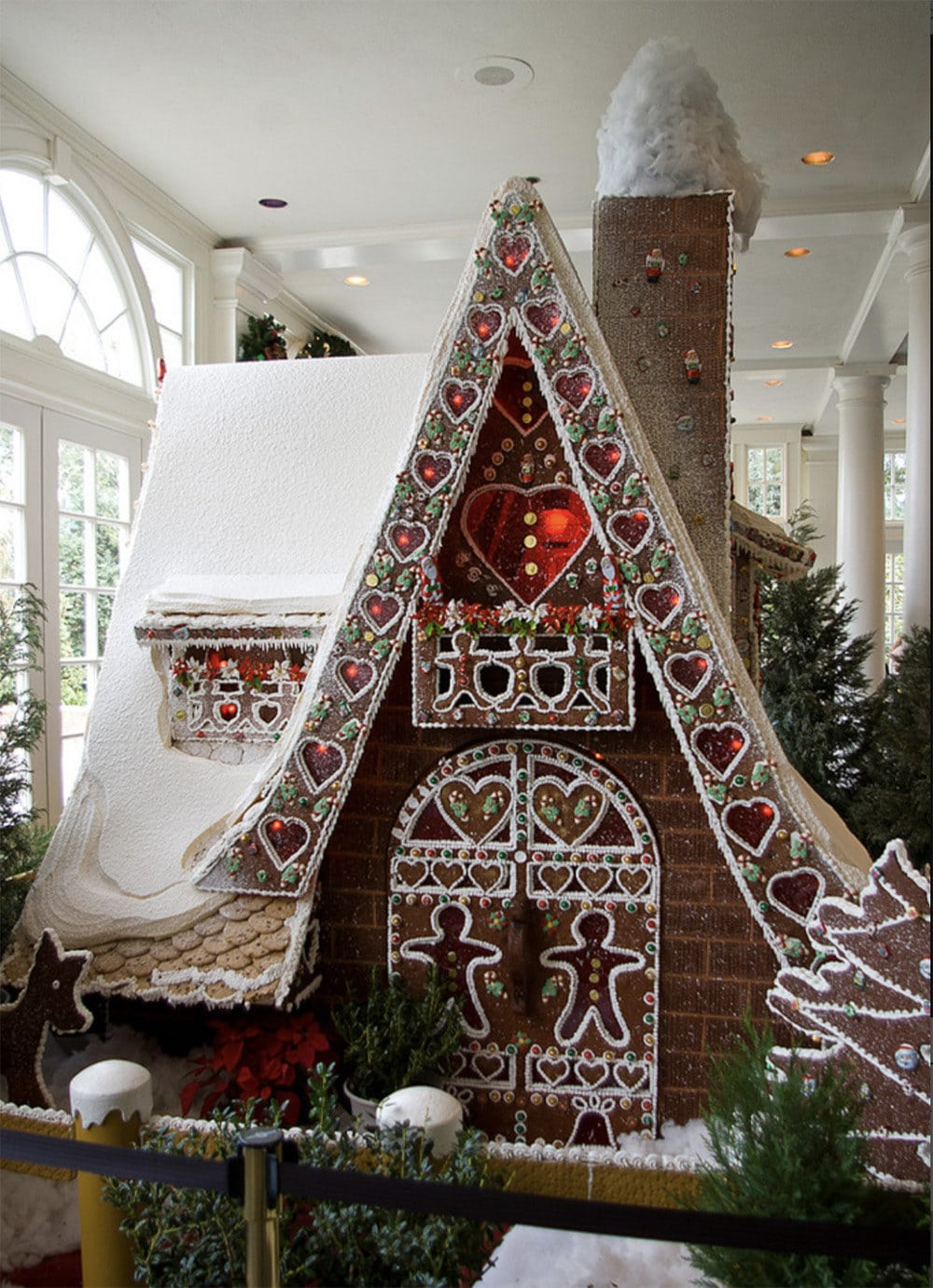 lovely A-frame gingerbread house with amazing piped doors and sugar glass windows
