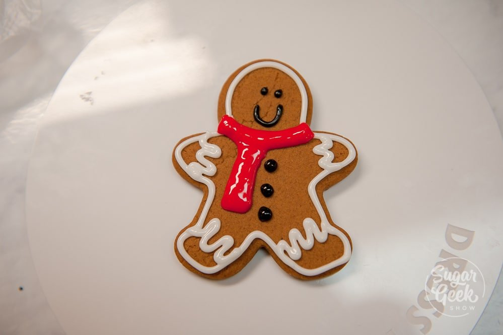 Add some dots to the front of the gingerbread man for his buttons
