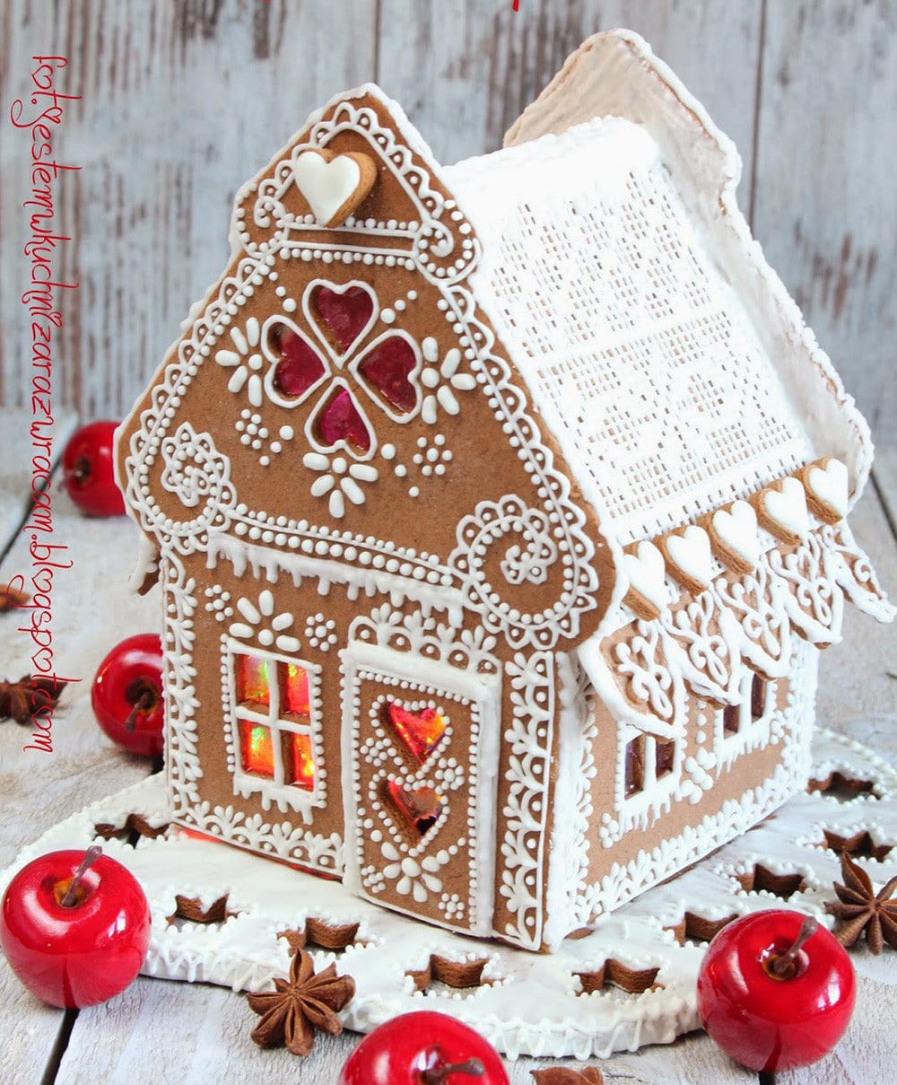 What a beautiful gingerbread house! Delicate royal icing piping and melted sugar windows. So elegant