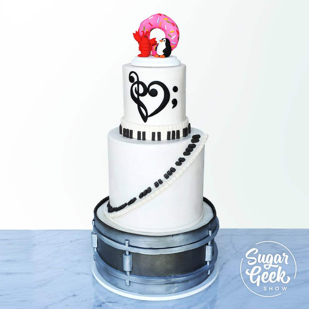 Music is like a dream, and this wedding cake is no exception! Learn how to craft a drum tier, a beautiful staircase piano key double barrel, a musical heart detail, and a keepsake cake topper, made out of clay that will never go bad. There's plenty of details, tips and tricks to cover, so let's get started!