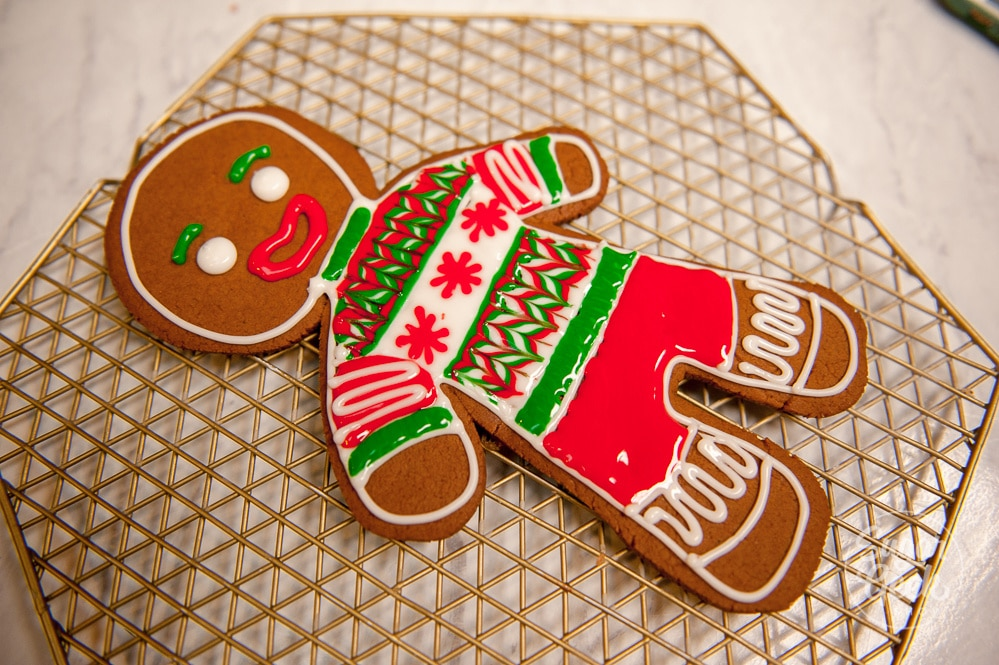 giant gingerbread man cookie with ugly sweater