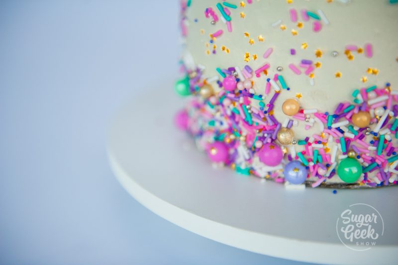 sprinkles on the side of a cake