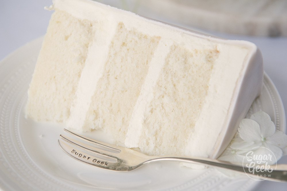 close up of WASC white almond sour cream cake, the best doctored box mix recipe for white cake