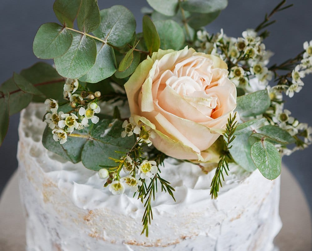 how to safely add fresh flowers to your wedding cake