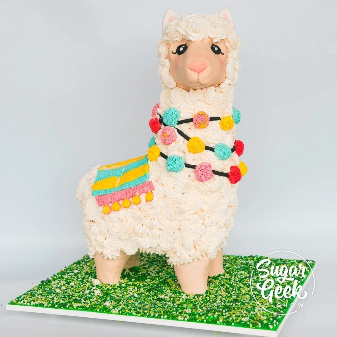 We continue our cake structure series with a cute no prob llama cake using threaded rod as the cake structure. Liz Marek breaks down how to use threaded rod, how to cut it without damaging the threads, how to measure and scale up a photo reference picture, along with all the fun details that make this llama shine!  We've got a lot of fun tips and tricks in this tutorial, including how to make edible pom poms, how to carve down cake and estimate the widths of objects if you only have 1 photo. Let's get our tools and materials together and let's get started!