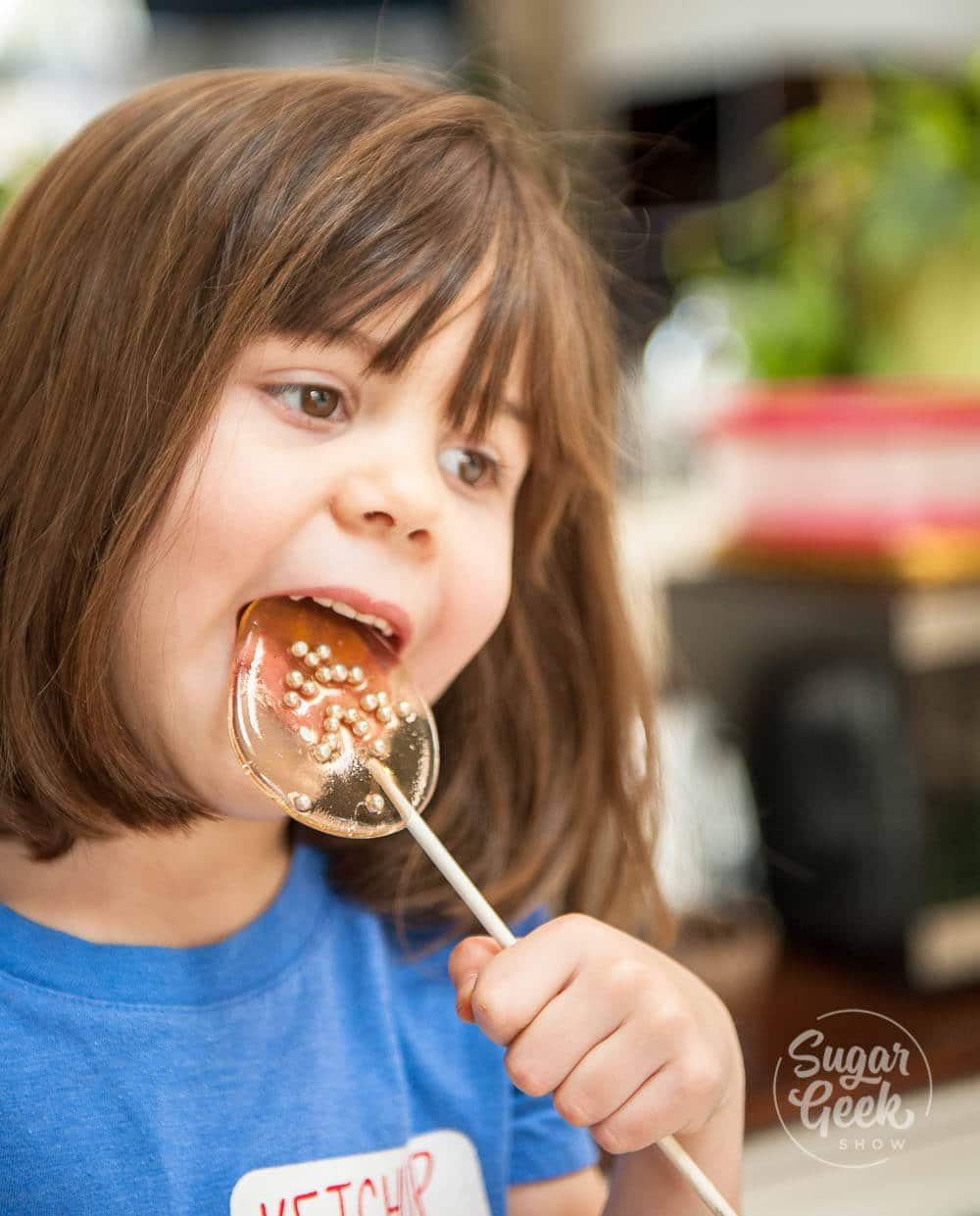 little girl eating homemade lollipop
