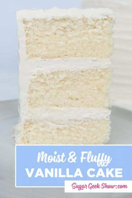 Slice of moist vanilla cake with buttercream frosting on a white plate