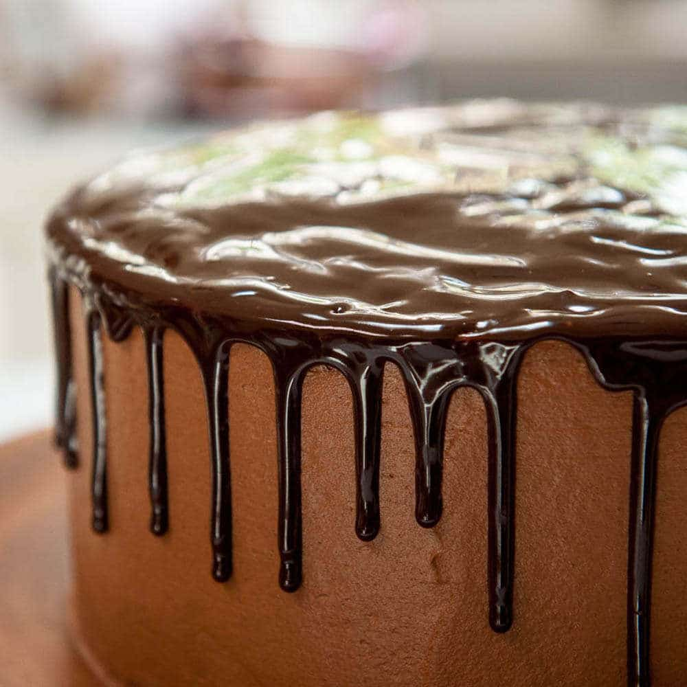 chocolate drip on chocolate buttercream cake