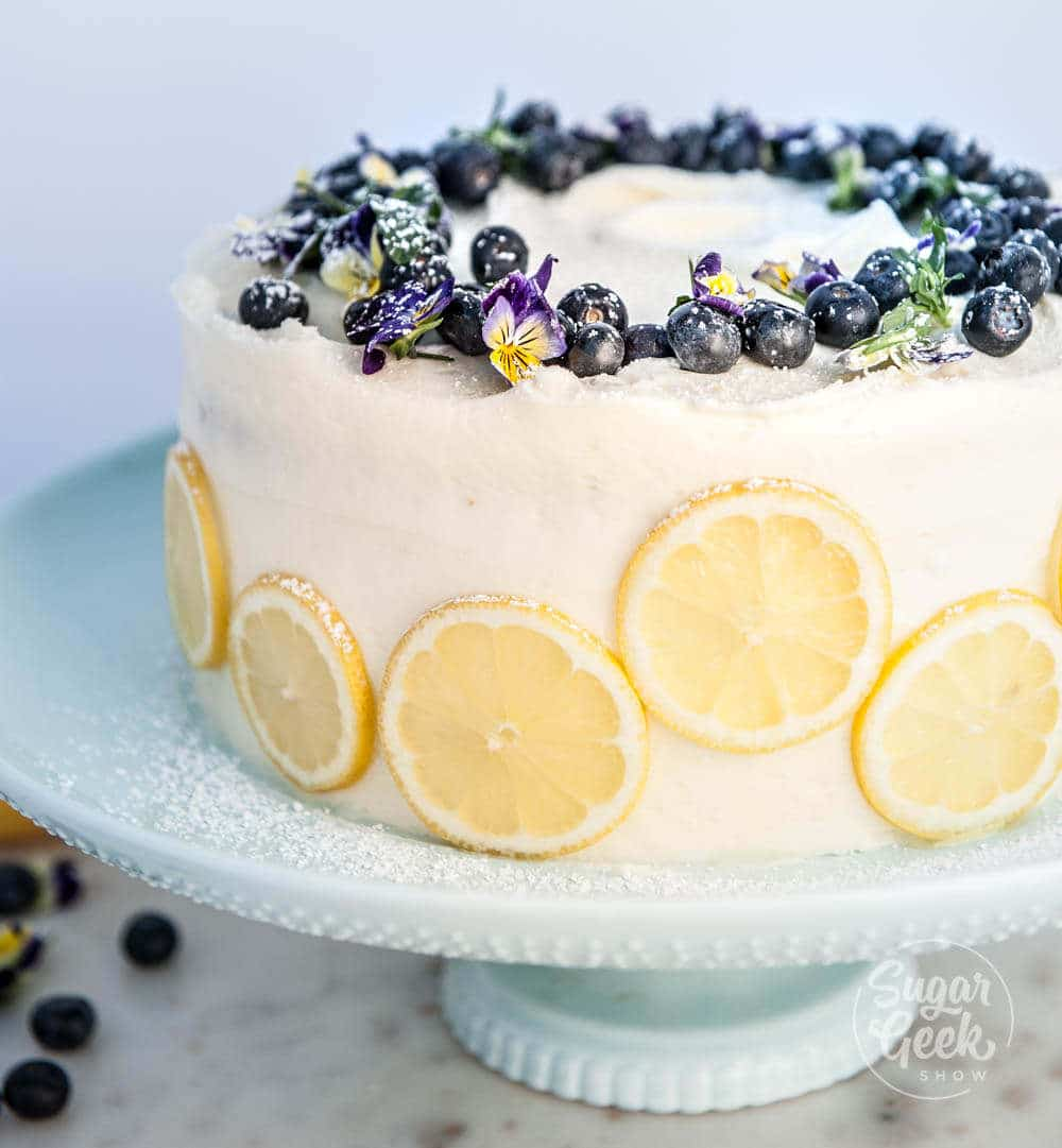lemon blueberry buttermilk cake with cream cheese frosting, lemon slices and fresh blueberries