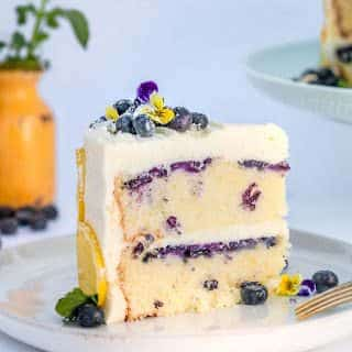 slice of lemon blueberry cake on a white plate