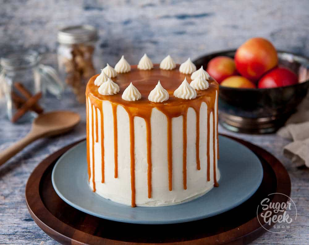 Applesauce cake frosted with cream cheese frosting and a caramel sauce drip