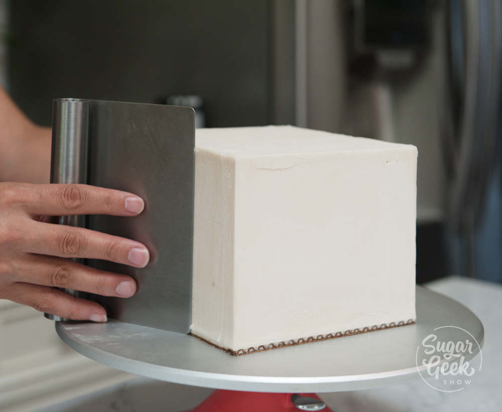 Clean up the edges of your square cake with a warm spatula