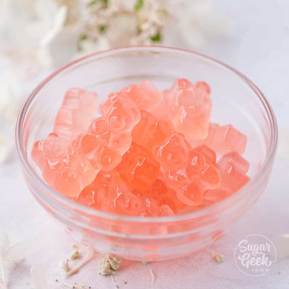 rose wine gummy bears in a glass bowl