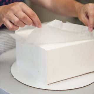 Remove the acrylics and parchment paper
