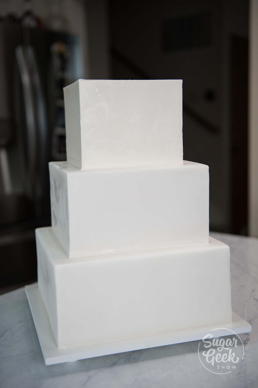 finished three tier square wedding cake
