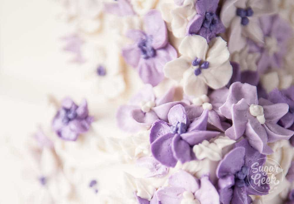 close up of purple buttercream flowers