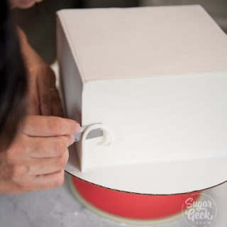 Trim off the excess fondant with a sharp razor blade