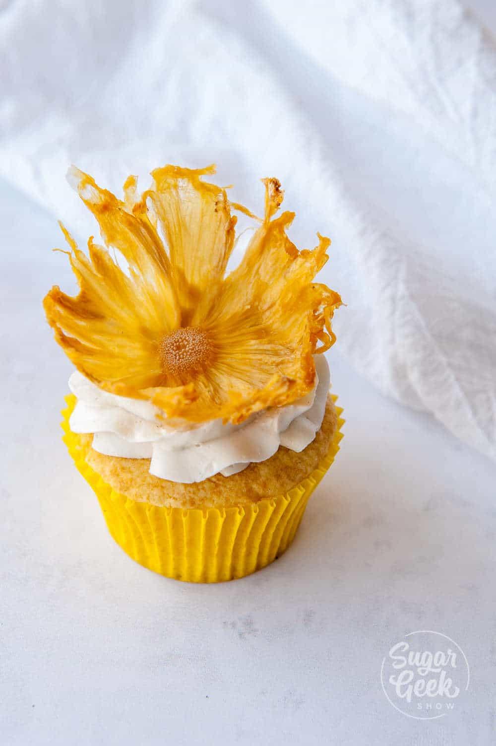 dried pineapple flower on cupcake