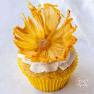 dried pineapple flower on vanilla cupcake