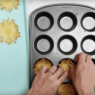 Place warm slices into a cupcake tin until cool and the pineapple slices can hold their shape