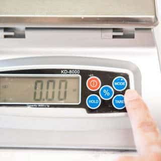set your digital kitchen scale to ounces or grams using the mode button