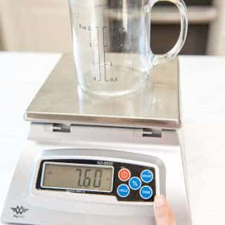 Place the container on top of the scale then press tare or zero to remove the weight of the container and bring your display back to zero