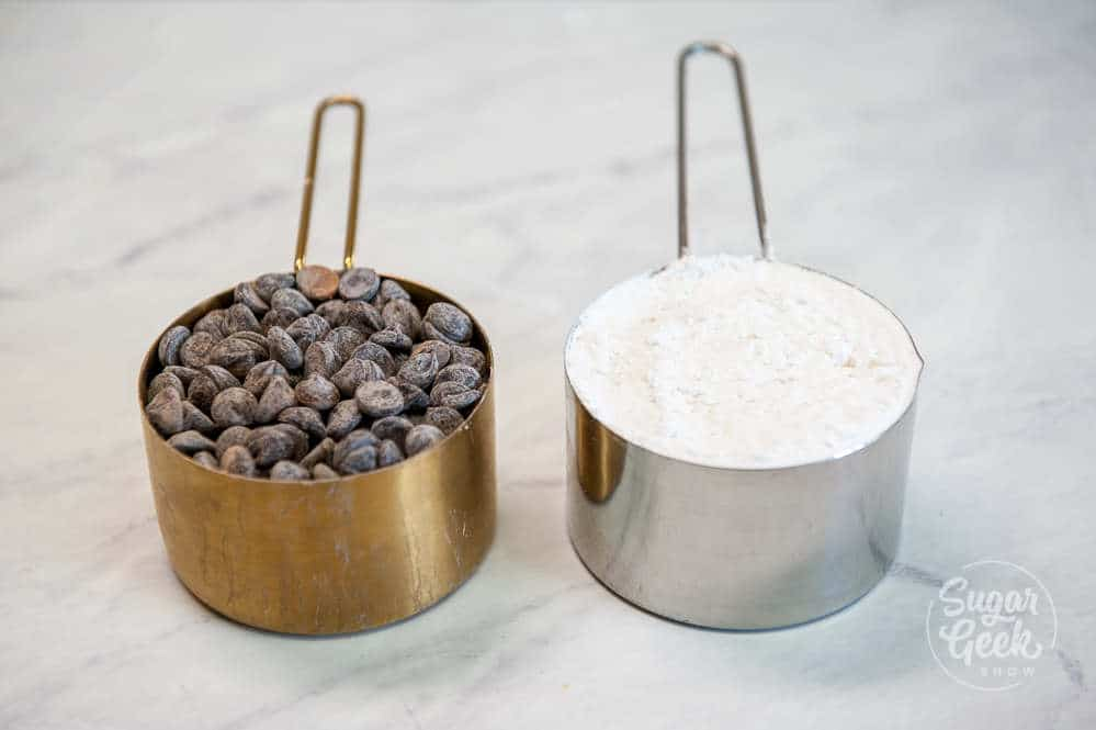 one cup of chocolate chips and one cup of flour side by side