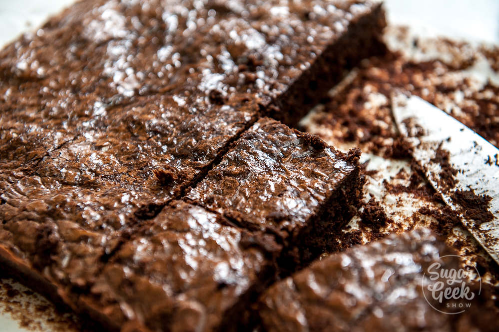 homemade brownies being cut into squares