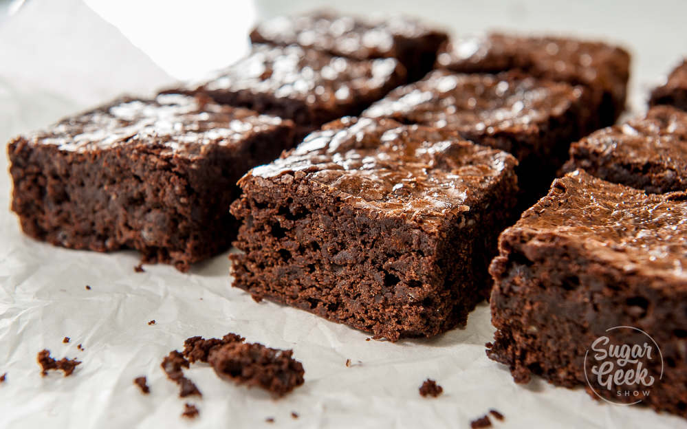 homemade brownies cut into squares on parchment paper