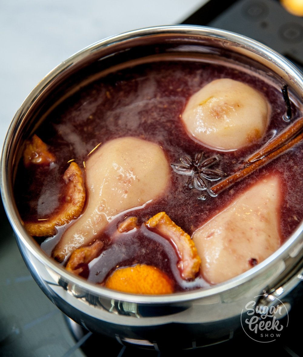 pears in poaching liquid with orange peel, star anise and cinnamon sticks