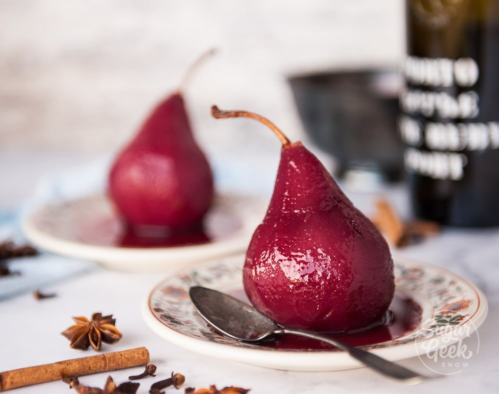 poached pears in red wine on a plate with spices